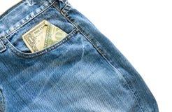 Jeans med den amerikanska dollarräkningen på dess fack Arkivfoton