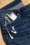 Jeans med walkmanen Arkivfoton