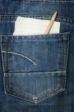 Jeans met een document nota Stock Afbeeldingen