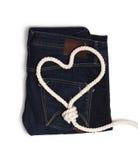Jeans met een kabel van het hart Stock Afbeelding