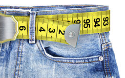 Jeans with meter belt slimming. Isolated on the white background royalty free stock images