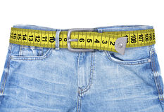 Jeans with meter belt slimming. Isolated on the white background royalty free stock image