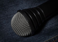 Jeans and microphone. Royalty Free Stock Photos