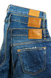 Jeans mit Aufkleber auf weißem Hintergrund Stockbild