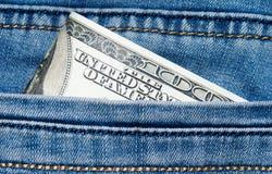 Jeans mit Dollar in der Tasche Lizenzfreie Stockfotografie