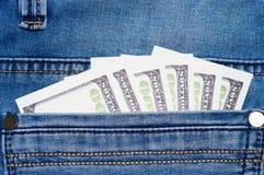 Jeans mit Dollar in der Tasche Stockfotos