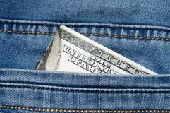 Jeans mit Dollar in der Tasche Lizenzfreies Stockfoto