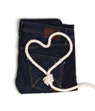 Jeans mit einem Seil vom Herzen Stockbild