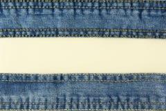 Jeans mit Stichhintergrund Stockbilder