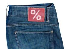 Jeans mit Verkaufs-Symbol Lizenzfreie Stockfotos