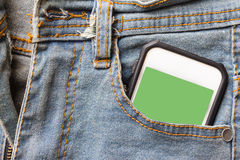 Jeans and mobile phone green screen. Stock Image