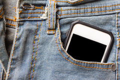 Jeans and mobile phone. Stock Photo