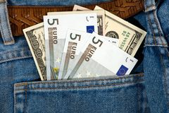 Jeans with money. Stock Images