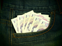 Jeans with money Royalty Free Stock Photo