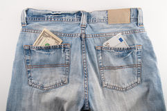 Jeans with money Royalty Free Stock Photos