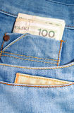 Jeans and a money bill. A PLN bill sticking out of the pocket in a pair of jeans Royalty Free Stock Image