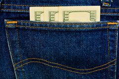 Jeans and money, fabric, denim indigo Royalty Free Stock Photography