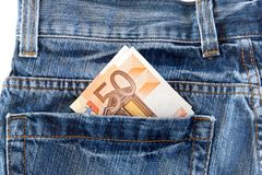 Jeans with money in the pocket Royalty Free Stock Image