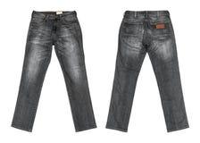 Jeans neri su fondo bianco fotografia stock libera da diritti