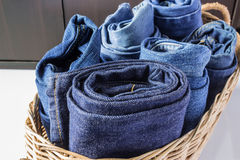 Jeans. New Jeans in the basket Royalty Free Stock Photos