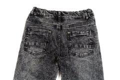 Jeans noirs, vue arrière, plan rapproché Isolat sur le blanc Image libre de droits