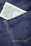 Jeans och dollar Arkivfoto
