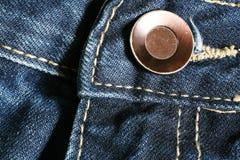 Jeans och knapp royaltyfria foton