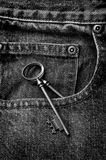 Jeans with Old Key in Pocket Stock Images