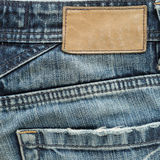 Jeans pants with back pocket and brown tag. Jeans pants with back pocket and brown leather tag Royalty Free Stock Image