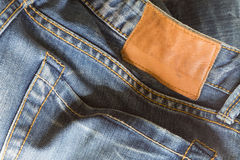 Jeans pants with back pocket and brown tag. Jeans pants with back pocket and brown leather tag Stock Photo