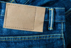 jeans pants with back pocket and leather tag Stock Image