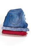 Jeans and pants folded on the stack. Royalty Free Stock Photos