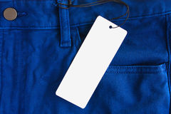 Jeans with paper price tag Stock Photo