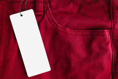 Jeans with paper price tag Royalty Free Stock Photos
