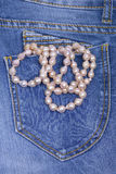 Jeans and Pearl Necklace Stock Photography