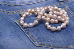 Jeans and Pearl Necklace Royalty Free Stock Photos