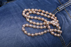 Jeans and Pearl Necklace Royalty Free Stock Photography