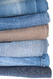 Jeans pile isolated on white background. Royalty Free Stock Photo