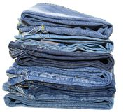 Jeans pile isolated on white background. Royalty Free Stock Image