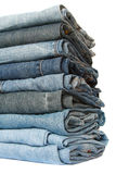 Jeans pile over white, soft focus Royalty Free Stock Photo