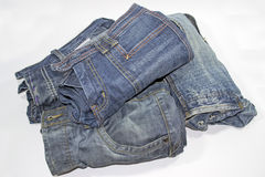 Jeans pile Stock Images