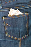 Jeans pocket. Pants jeans with money in the pocket royalty free stock images