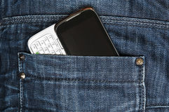 Jeans pocket. Closeup to jeans pocket with phone stock photos