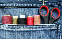 Jeans pocket. Closeup to jeans pocket with tailor tools Royalty Free Stock Photo