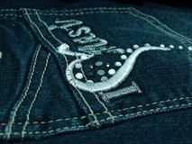 Jeans Pocket. Close-up of dark blue jeans pocket stock photography