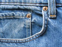 Jeans pocket. Detail of a front pocket in a blue jeans pants stock photo