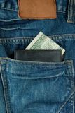 Jeans Pocket And Money With Purse Royalty Free Stock Photos