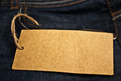 Jeans pocket with blank tag. Blank brown tag with rope from blue jeans pocket Stock Images