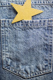 Jeans pocket. Blue jeans texture pocket and christmas decor Royalty Free Stock Photos