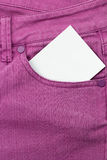Jeans Pocket. Close up of jeans pocket with blank paper royalty free stock photo